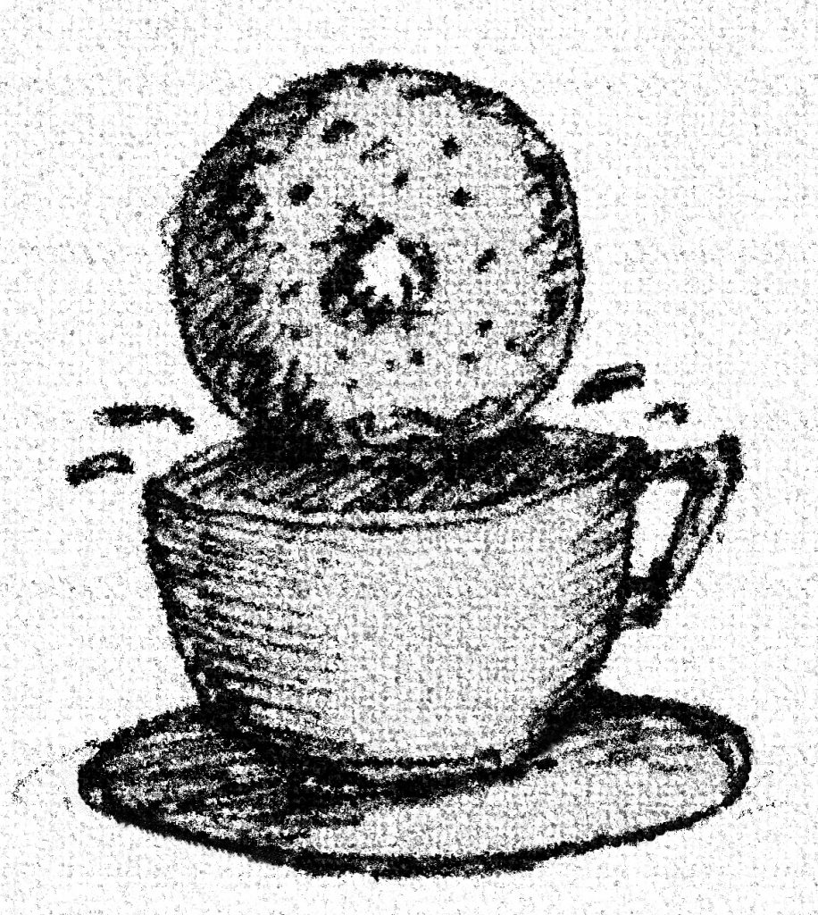 Donut dunking into a coffee cup